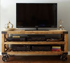 Recycled pine wood + industrial wheels = awesome entertainment console