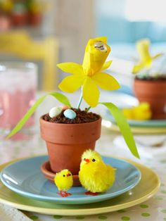 Paper daffodil w/ chocolate center in potted cupcake with crushed chocolate cookie soil.