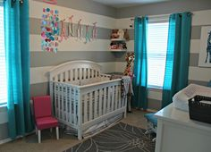 This #gray #stripe #nursery looks amazing with #turquoise & #raspberry accents.