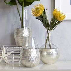 Great for Mom: With its honeycomb texture and cool, shining glow, these hand-painted Honeycomb Vases add decorative polish to floral arrangements.