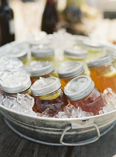 Flavored teas served in mason jars in an ice bucket -- great for outdoor parties! | cloud.feedly.com