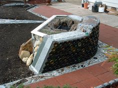 up-cycled wine bottle Fire Pit by Chris Emmert