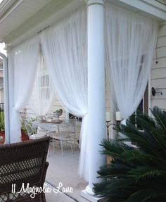 DIY Screened Porch (When You Don't Have a Screened Porch!) - I just may have to try this on my front porch.  But may add a fabric tape across the top.  I'm on a ridge and the wind has torn up several roll-up shades.  So I need to be able to remove them quickly.