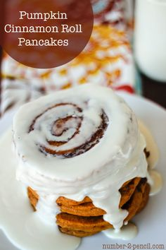 Pumpkin cinnamon roll pancakes recipe with a cream cheese glaze....yum! Perfect for fall!