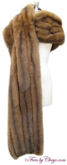 SOLD! Long Russian Sable Stole #RS722; Like New Condition; One Size Fits Most. This is an exceptional genuine natural Royal Crown Russian sable fur stole in a very rare extra long length. This is a very, very high quality piece, and the desirable silvery tips are plentiful (one indication of high quality sable fur). It is constructed of four rows of sable pelts with dark brown silk between each row.  It has an I. Magnin & Co. label. When you desire luxury at its finest buy this sable stole!
