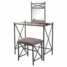 """Glass-top vanity with a metal frame and matching upholstered seat.  Product: Vanity and vanity stoolConstruction Material: Metal, MDF, mirrored glass, foam and fabricColor: MetalFeatures: Decorative """"X"""" sidesDimensions: Vanity: 31"""" H x 31"""" W x 18"""" D Bench: 14"""" H x 17"""" W x 18"""" D"""