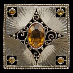 Theodor Fahrner. Jugendstil brooch. Silver and citrine. Length: 2.9 cm (1.1 in)   Width: 2.9 cm (1.1 in). Marked: 'TF' '935' & 'Depose'. German, c. 1908. Probably designed by Hermann Haussler. Sold by Tadema Gallery.
