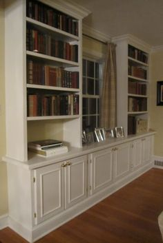 Inspiration for the basement built-ins (TV in middle instead of window).... One day!