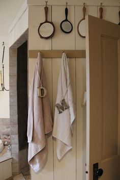 Love the antique mirrors hanging  and the letters on the towels