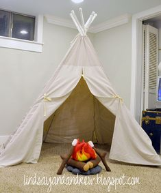 For those of us who can't wait for summer - DIY PVC tent and felt campfire from Lindsay and Drew. Full tutorial here.