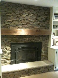 reclaimed wood beam mantel