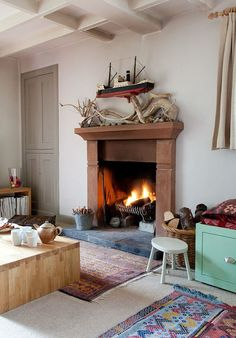 Lucy Dunce, British Isle Ceramicist, Edinburgh home, living room, wood boat and drift wood on mantel