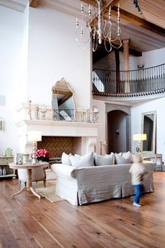 gorgeous living room {love the staircase and all the white}