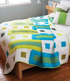 Mail Slots, featured in Easy Quilts Fall 2013, is a bed size quilt pattern featuring brightly colored quilt fabric set against a white background. Quilt by  Tony Jacobson.