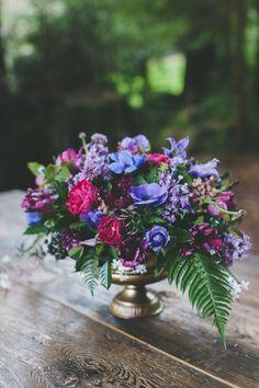 Jewel-toned floral arrangement in a classic gold urn. #wedding #flowers #berry #flowers #Nestldown #wedding