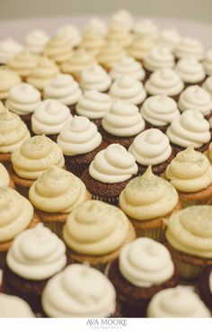 One more delicious angle - Anthony and Nicole's wedding cupcakes arranged in a monogram | photo credit Ava Moore Photography #WeddingCupcakes #CupcakeDownSouth #CharlestonSCweddings
