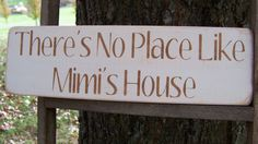 Mimi Distressed Wood Sign There's No Place Like Mimi's House. $12.00, via Etsy.