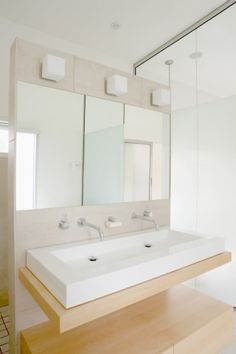 My master bathroom doesn't have enough room for double sinks, but maybe we could do a really long sink with 2 faucets?