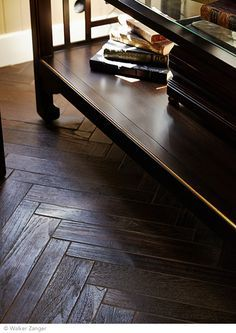 Walker Zanger AnTeak Collection makes a rich floor covering. Made from reclaimed teak wood.  Large Herringbone in Coffee.