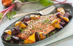 Spice-Crusted Salmon with Roasted Ginger Beets - This #dairyfree and healthy salmon recipe is crusted with whole peppercorns, coriander seeds, rosemary and coarse sea salt.