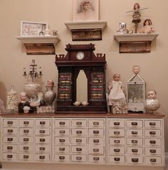 Lillys Lace: apothecary cabinet. Love the dark wood piece on top too.