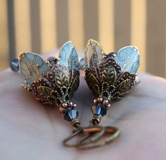 This Etsy artist creates beautiful earring with flowers.  She colors some of the metal with beautiful colors. Wonderful design and quality.