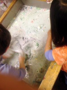 Teacher Tom's version of the shaving cream cloud experiment included putting the 'used' clouds and water into the water table.