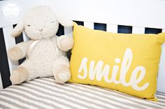 This pillow makes me smile. #yellow #baby #nursery