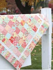 Summertime Charm Quilt Pattern from AnniesCatalog.com -- Use this charm pack and jelly roll friendly quilt to make a table topper, wall hanging or picnic blanket for a warm, sunny afternoon!