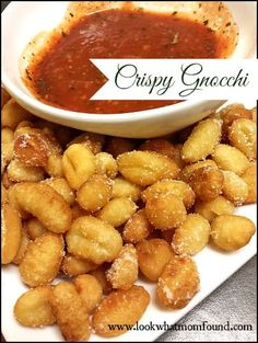 Crispy Gnocchi #recipe Fry quickly to a beautiful golden brown. Drain on paper towels then sprinkle with salt and parmesan cheese. Serve with a spicy tomato sauce, a jar sauce doctored up with LOTS of red pepper flakes and crushed basil.