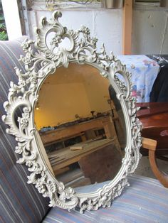 "Syroco framed mirror circa 1965, painted in ""fossil"", I thought it is much better than the original gold."