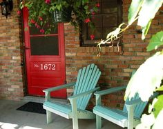 """Front facade inspiration.  Red door - and AQUA shutters (when we get shutters - our house is supposed to have them - the original """"shutter dogs"""" are still on the house).   Think this color combo will look even better on a gray stone house versus brick."""