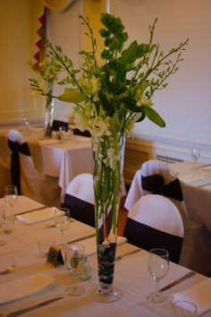 Centerpieces: White Dendrobium Orchids, White Oriental Lilies, Bells of Ireland, White Freesia