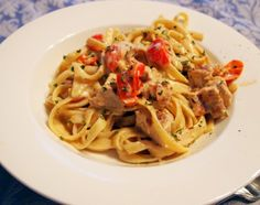 Cajun Chicken Fettuccine Alfredo | ComfortablyDomestic.com. My most popular recipe! Fettuccine enrobed in a creamy Alfredo sauce with several varieties of cheese, tossed with spicy cajun-style chicken and fresh tomatoes.