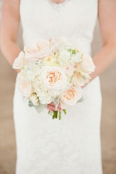 Classic blush & ivory #bouquet | Photography: Jen Shannon - jenshannon.com  Read More: http://www.stylemepretty.com/southeast-weddings/2014/04/28/palm-coast-beach-wedding-with-modern-touches/