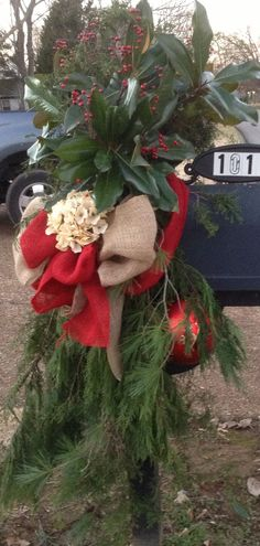 Christmas 2013 - Natural Burlap, Red Burlap, Off-white Hydrangea, Red Berries, an Over-sized Ornament, and Fresh Evergreens create a beautiful Christmas mailbox - side two.