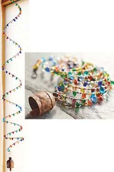 swirling bead chime- memory wire seed beads and larger beads with Nana bell at end.
