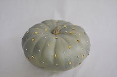 For this glamourous pearl pumpkin we applied a small dot of glue with a toothpick on our pumpkin and immediately placed a pearl bead or gold...