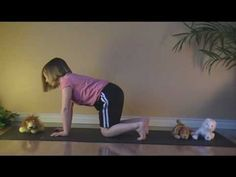 How stuffed animals can help kids perform yoga poses (cat pose, downward dog pose, lion pose) from YogaInMySchool.