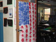 American flag classroom door decoration made from children's handprint cutouts
