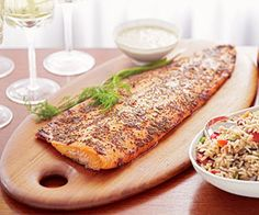 This easy baked salmon fillet is topped with mustard, brown sugar, and fresh dill.