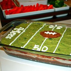 Super Bowl-Themed Mexican 7 Layer Dip | getoffyourtushandcook.com layer dip