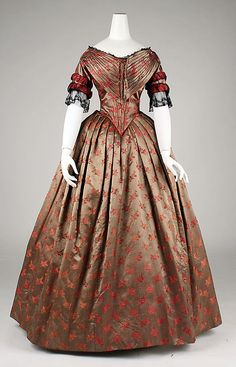 Red-gold silk brocade evening dress with black lace trim, American or European, ca. 1842.