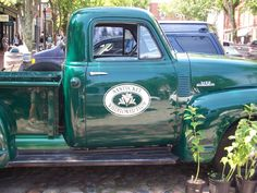 Vintage farm truck bringing flowers to town