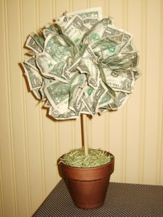 Money Tree! Great wedding or graduation gift idea.  10 cool points for visual interest!