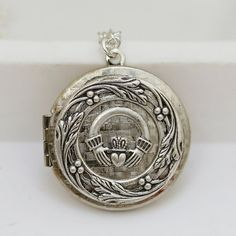 Irish Claddagh Locket. Love the claddagh ring tradition and love lockets.. perfect!