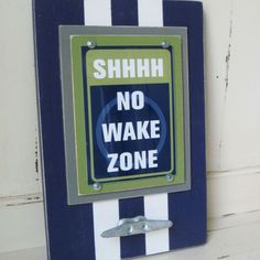 """Framed Shhhh, No Wake Zone Print with Boat Cleat - The Project Cottage - This cool frame is perfect for your nautical nursery decor! This frame holds a Project Cottage Original 5×7 Beach Sign Print that says """"Shhh, No Wake Zone"""" and has a Galvanized Boat Cleat for a unique Nautical touch."""