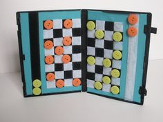 handmade by stacy vaughn: travel checkers board from a dvd case, velcro and buttons! Math strategy game? Why, yes, I think it is!!