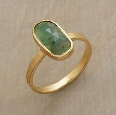 Emerald Pool Ring  Pools of light reveal the depths of a faceted emerald warmed by matte, hammered 18kt gold. Handmade in USA by Jennifer Dawes.