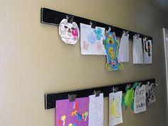 Cute way to display the kids art work!